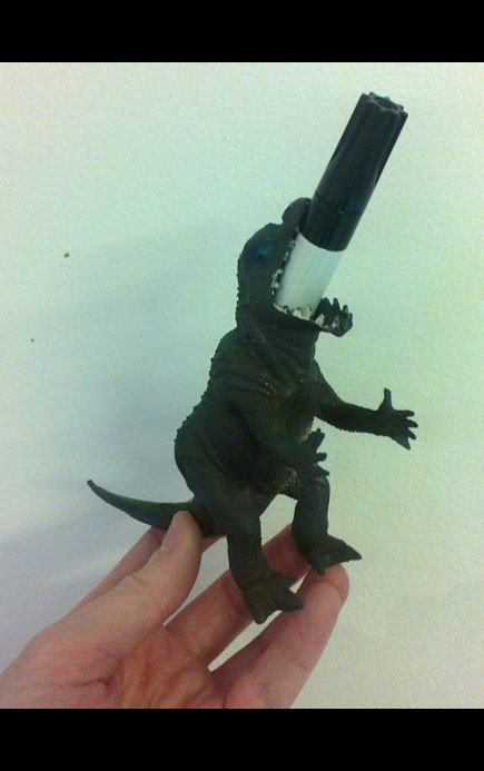 Dinosaure pen holder.